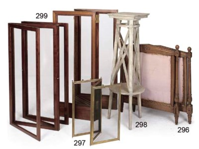 A FRENCH WALNUT BED IN THE DIR