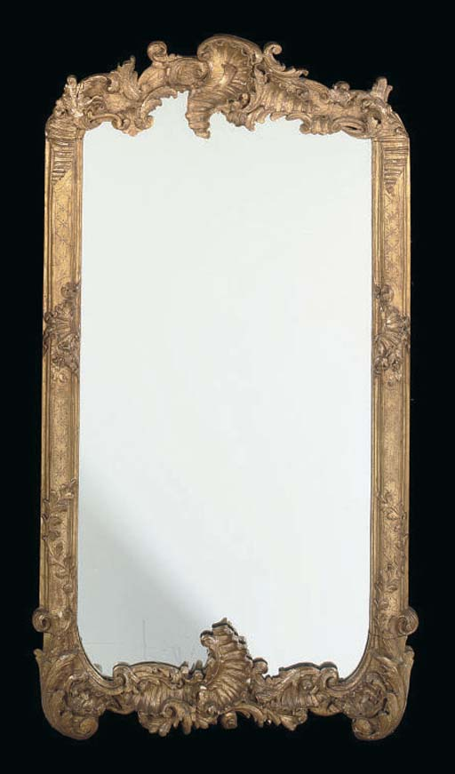 A GOLD PAINTED CARVED MIRROR