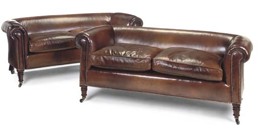 A PAIR OF LEATHER UPHOLSTERED SOFAS