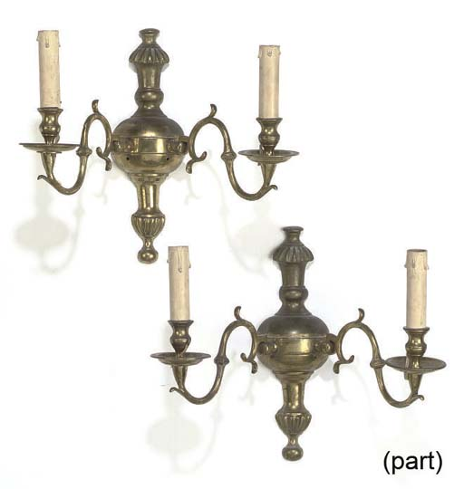 A SET OF FOUR BRASS WALL APPLIQUES