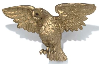 A GILT-WOOD EAGLE FINIAL