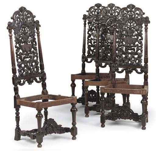 A SET OF FOUR CARVED WALNUT SIDE CHAIRS