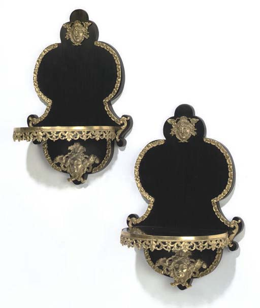 A PAIR GILT-BRONZE MOUNTED EBONISED WALL BRACKETS