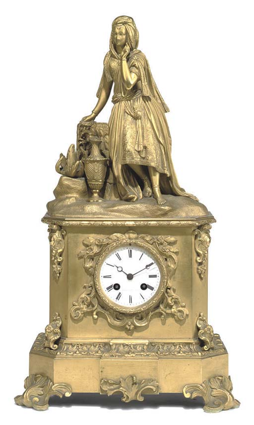 A FRENCH GILT-BRONZE MANTEL CLOCK