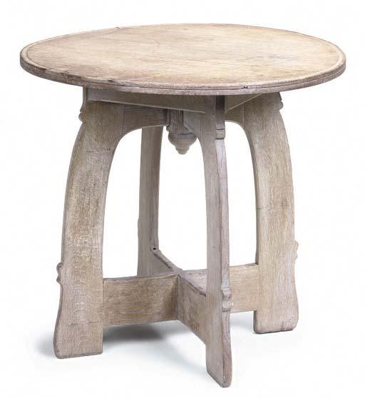 A LIMED OAK CIRCULAR CENTRE TABLE