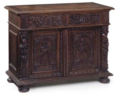 A FLEMISH CARVED OAK SIDE CABI