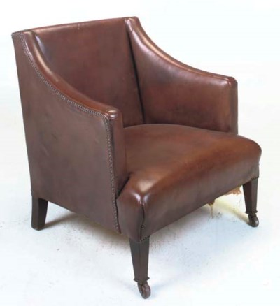 A LEATHER UPHOLSTERED LOW ARMC