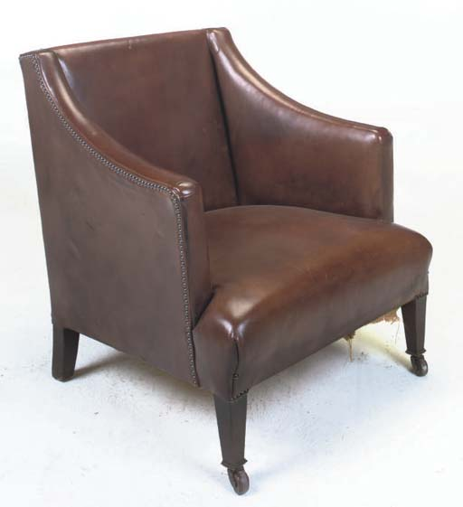 A LEATHER UPHOLSTERED LOW ARMCHAIR