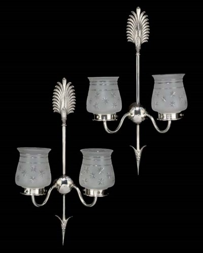 A PAIR OF SILVERED METAL TWIN-