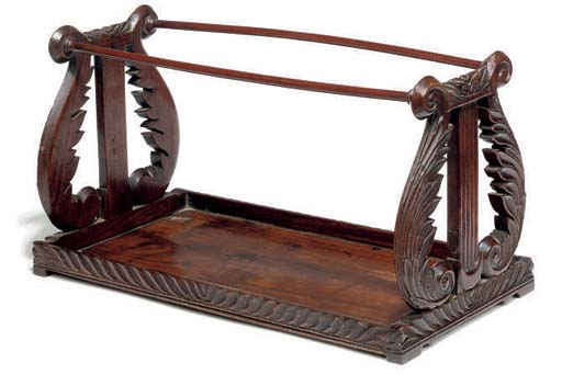 AN ANGLO-INDIAN ROSEWOOD BOOK RACK