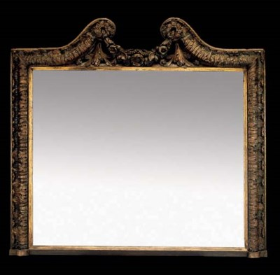 A CARVED GILT-WOOD MIRROR