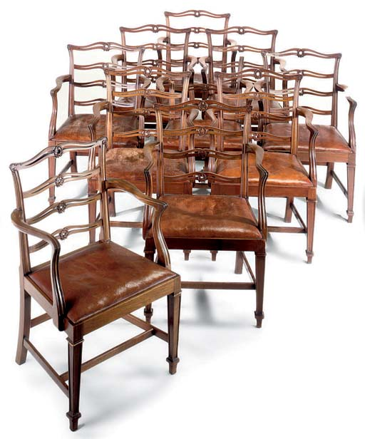 A SET OF TEN MAHOGANY LADDER BACK DINING CHAIRS