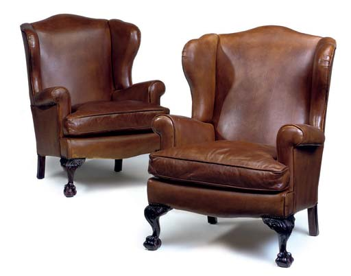 A PAIR OF LEATHER UPHOLSTERED WINGBACK ARMCHAIRS