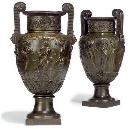 A PAIR OF BRONZE CLASSICAL VASES