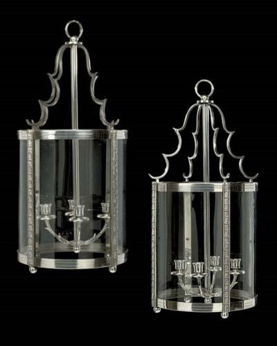 A PAIR OF SILVERED-METAL CYLIN