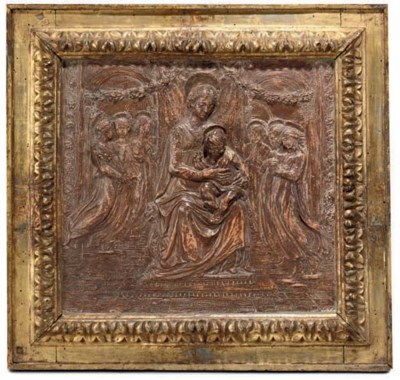 A PAINTED TERRACOTTA RELIEF OF