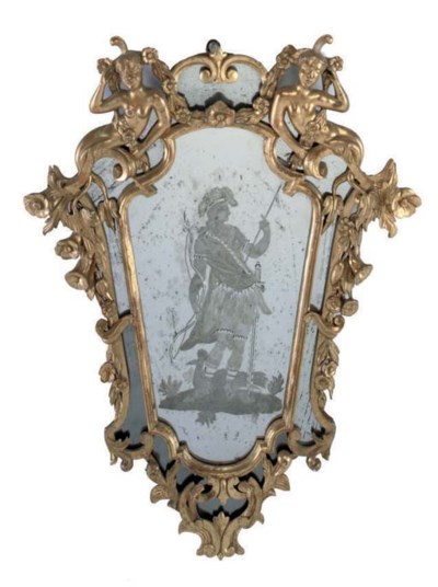 AN ITALIAN CARVED GILTWOOD MIR