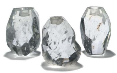 A SET OF THREE CRYSTAL GLASS C