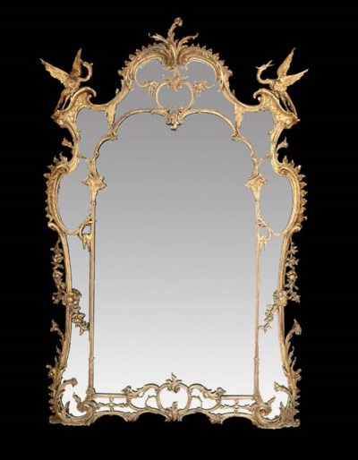 A LARGE CARVED GILTWOOD OVERMA