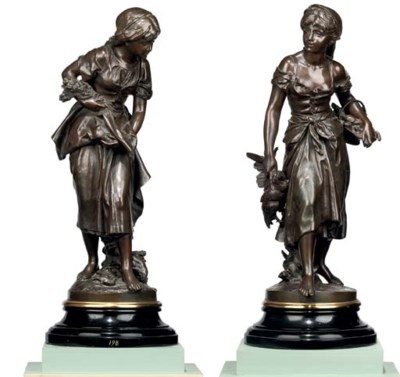 A PAIR OF BRONZE FIGURES OF GI