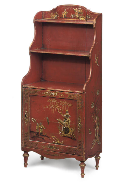 A RED PAINTED OPEN BOOKCASE