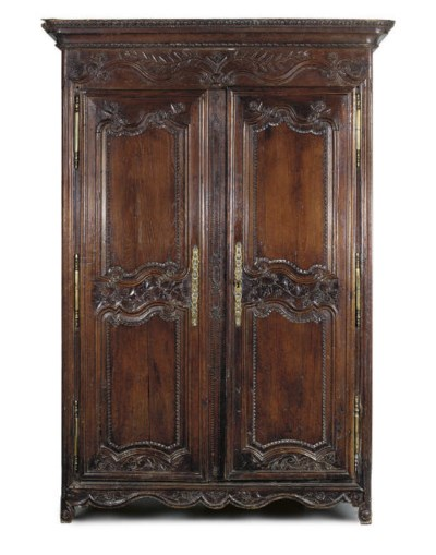 A FRENCH PROVINCIAL CARVED OAK