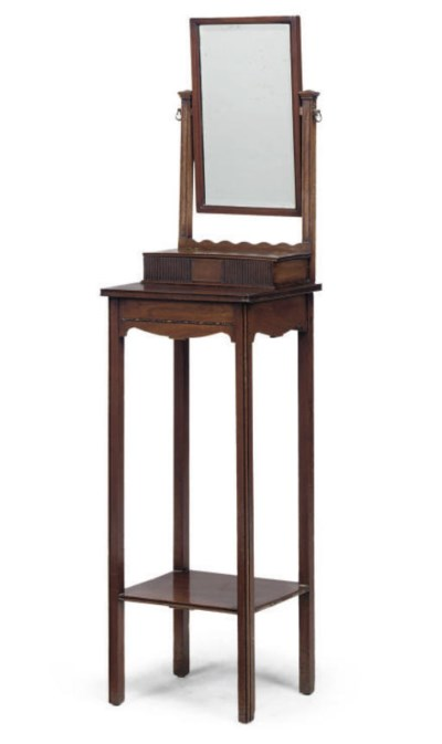 A MAHOGANY TOILET MIRROR ON ST