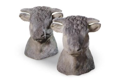 A PAIR OF COMPOSITE STONE BULL