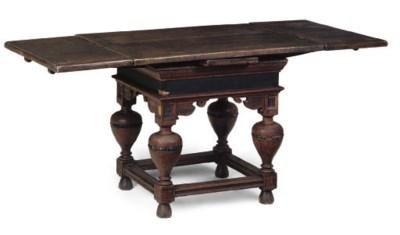 AN OAK DRAWER LEAF DINING TABL