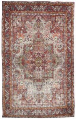 An antique Kirman carpet