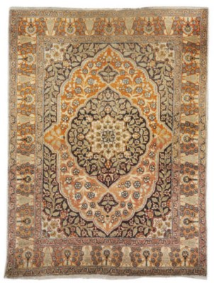 An antique Tabriz rug