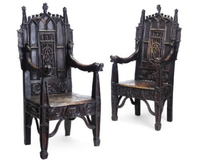 A PAIR OF CARVED OAK HALL CHAI