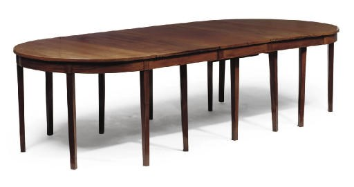 A MAHOGANY D END DINING TABLE