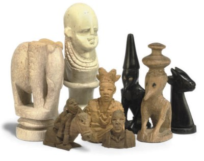 AN AFRICAN CARVED HARDWOOD AND