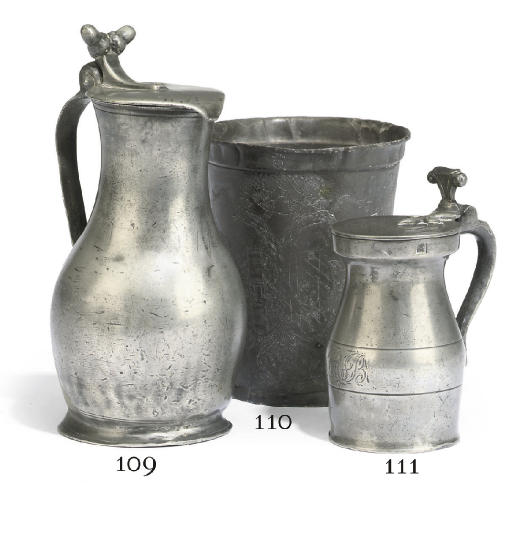 A GERMAN ENGRAVED PEWTER BEAKE