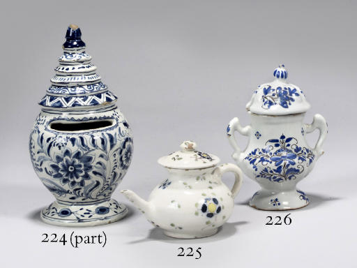 A DELFTWARE DATED MONEYBOX AND