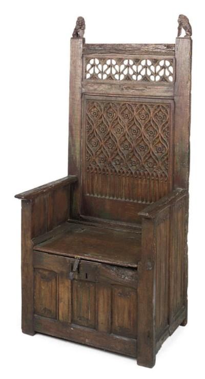 A FRENCH OAK BOX-SEAT THRONE C