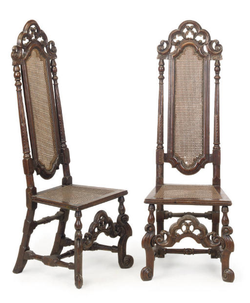 A PAIR OF ENGLISH WALNUT CANED