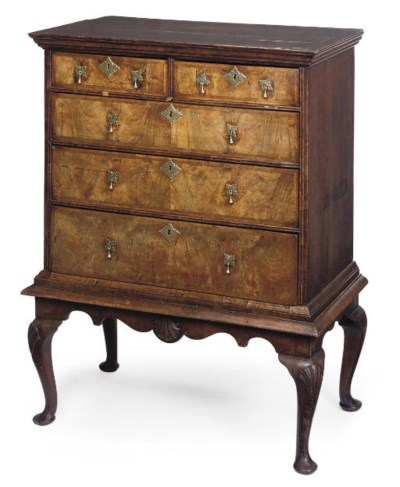 A WALNUT AND OAK CHEST-ON-STAN