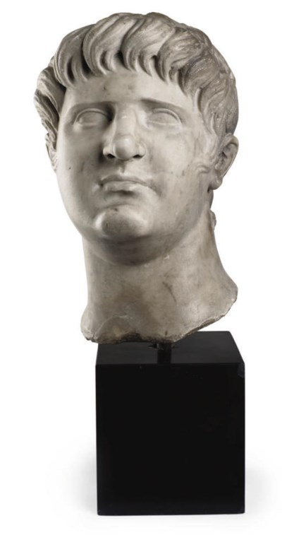 A CARVED MARBLE BUST OF CAESAR
