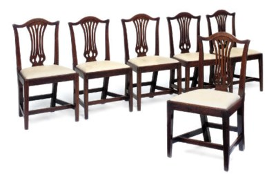 A SET OF SIX GEORGE III OAK DI