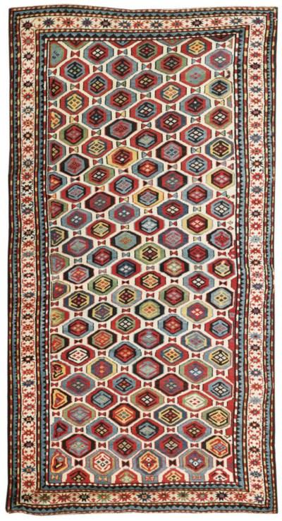An unusual antique Kazak rug,