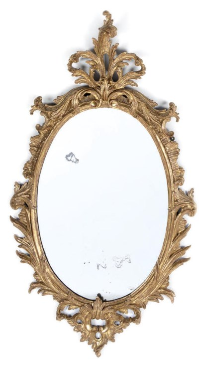 A CARVED GILTWOOD OVAL WALL MI
