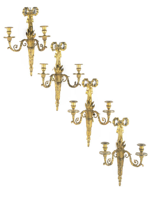 A SET OF FOUR GILT-BRONZE TWIN-LIGHT WALL APPLIQUES