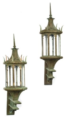 A PAIR OF PATINATED BRASS LANT