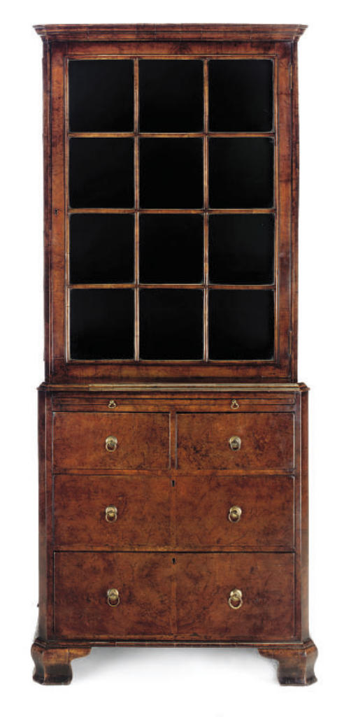 A WALNUT DISPLAY CABINET