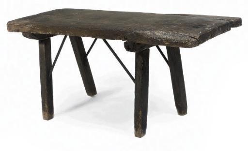 A SPANISH OAK CENTRE TABLE