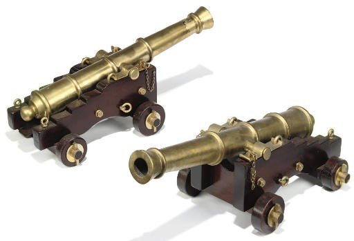 A PAIR OF BRASS AND MAHOGANY M