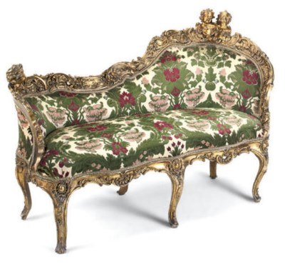 A CARVED GILTWOOD AND UPHOLSTE