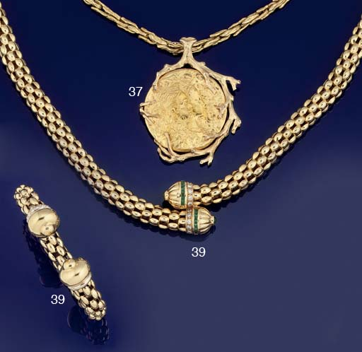 AN EMERALD AND DIAMOND SET NECKLACE AND A DIAMOND SET BRACELET